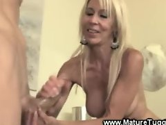 Blonde mature whore wanks cock