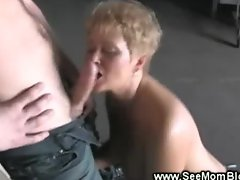 Blond milf on hard young cock sucking away at it