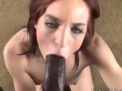 Beautiful redhead Riley Shy swallows a big black thugs cock