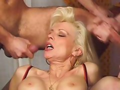 Horny mother double penetrated by two friends on the table