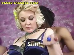 Slutty tattooed blonde bitch Candy goes black while a naughty cuckold sits in the corner