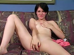Short-haired brunette with small tits fingers her yummy snatch