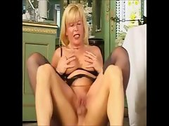 Busty mature blonde maid nibbles on his boner then gets banged