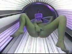 Spycam, teen in solarium