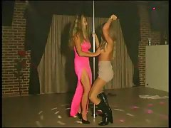 Two blondes poledancing