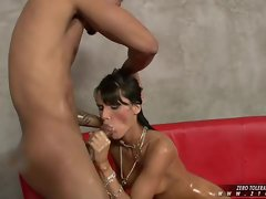 Porn-star Jennifer Dark swallowing fat, black, oiled, rod