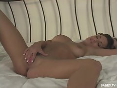 Hot babe Andie Valentino opens her dripping lips and fingers her pussy