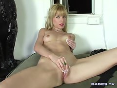 Angie Savage plays with her nice little pussy and keeps rubbing her clit