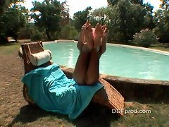 Hot blond Christina Blond enjoys showing off sexy body by the pool
