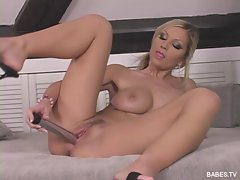 Clara G stuffs a huge dildo into her tiny pussy