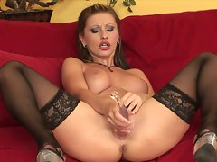 The slim juicy hole of Nikki Rider gets filled by a giant glass dildo