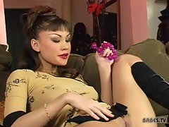 Asian slut Jade Hsu relaxes on the couch with self pleasure