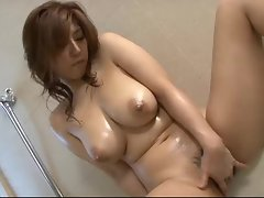 Gorgeous Japanese slut Naho oils up her pretty body