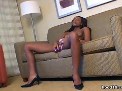 Sexy black girl pleasing herself