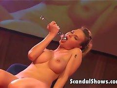 Hot brunette striper plays with a dildo