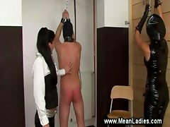 Dominas whipping and mastering anus
