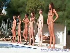 A bunch of chicks get naked out by the pool and show off their bodies