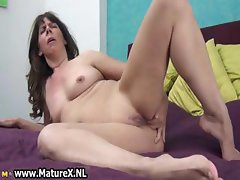 Naughty mature slut fucking her own part3