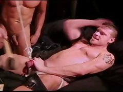 CBT Hot hung smooth muscle stud has balls punched and squeezed by a hot smooth Asian muscle stud.