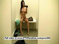 Hot naked brunette girl in a clothes shop