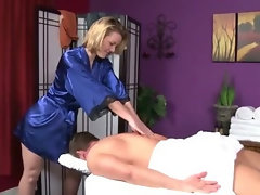 Massesue babe giving sexy massage to lucky client