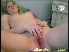 Busty blonde amateur showing pierced slit
