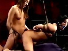 Dominatrix fucks girl with a strapon