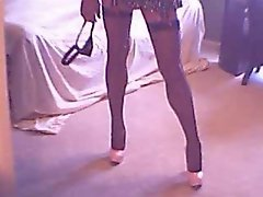 Babe Shemale in Mini Skirt, Stockings and Heels Plays