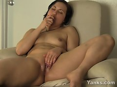 Constance from Yanks Pours Oil on her Bald Pussy