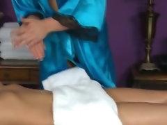 Blonde masseuse massages babes clitoris