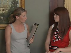 Ashlyn Rae in her cheerleader's outfit while her cunt is licked by Ariel Carmine