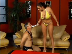 Big titted whore Gianna Michaels shows a submissive man who is boss