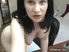 Hot MILF plays with self on webcam