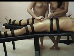 Nyomi and Amber Handjob Strapped Down
