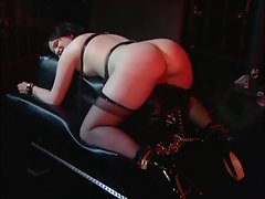 Sensual mistress delighting with her slave young woman