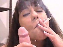 Brunette giving a smoking blowjob