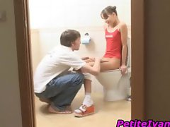 Petite teen gets slit licked on the toilet