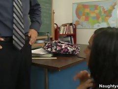 School girl fucks her teacher on the desk in the classroom