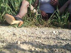 Crossdresser wanking in a wheat field