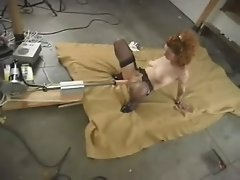 redhead getting it from a machine