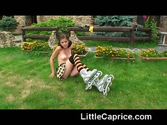 Little Caprice learns roller skating naked outdoors!