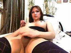 Sexy Asian ladyboy jerks off and cums.