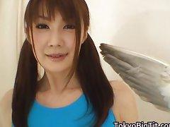 Erika Kirihara Asian model enjoys feather