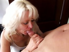 Mature aunt rides cock on zebra bed