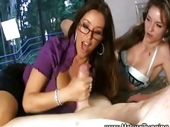 Horny milf and daughter giving a handjob