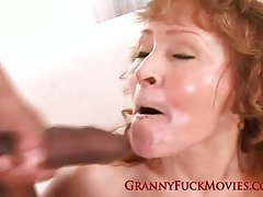 Granny enjoys a black cumshot