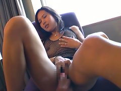 Naughty married asian babe in fishnets opens hairy pussy for play