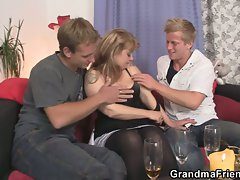 Mature bitch pleasures two young studs