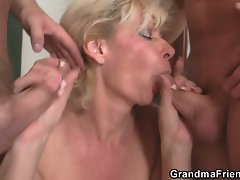 Blonde grandma sucking two cocks and getting banged