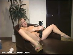 Blonde chick playing with a brutal dildo